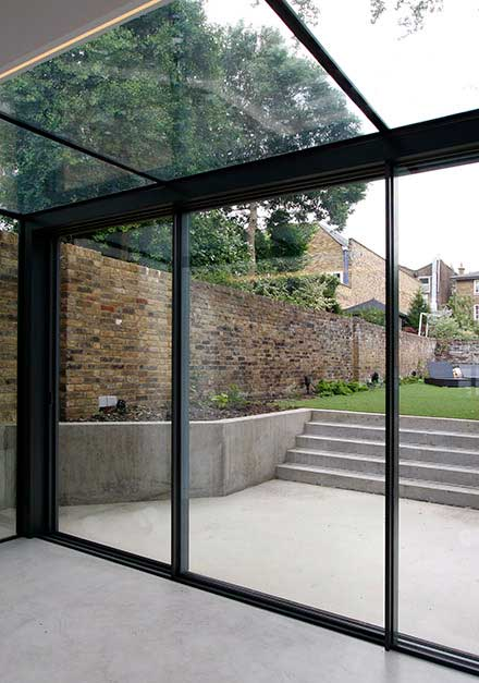 Glass extensions bespoke extensions conservatories for Conservatory sliding doors
